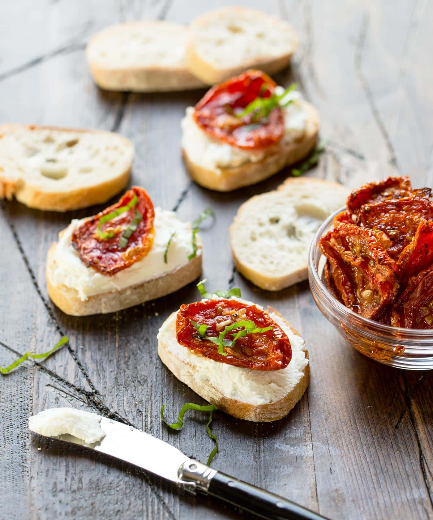 Slices of bread with roasted tomatoes.