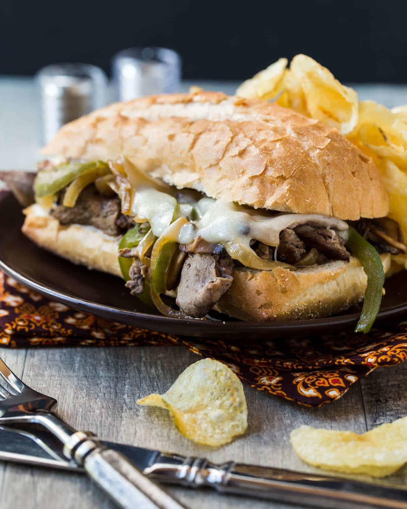 Nothing says game day like Cheesesteak Sandwiches. Add this recipe for melty, gooey Cheesesteaks to your next tailgating menu.