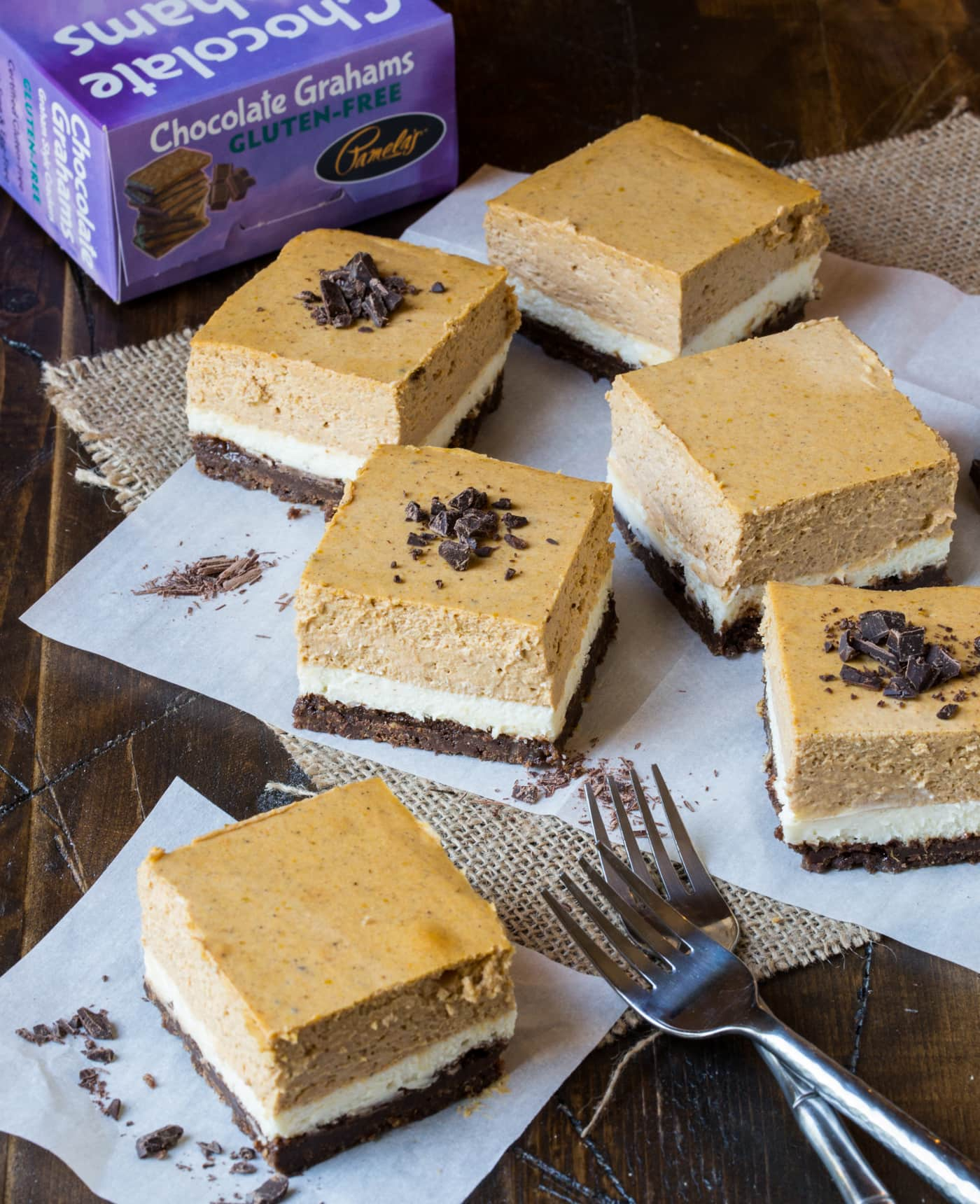 You'll never miss the wheat in these gorgeous layered Gluten-Free Chocolate Pumpkin Cheesecake Bars!