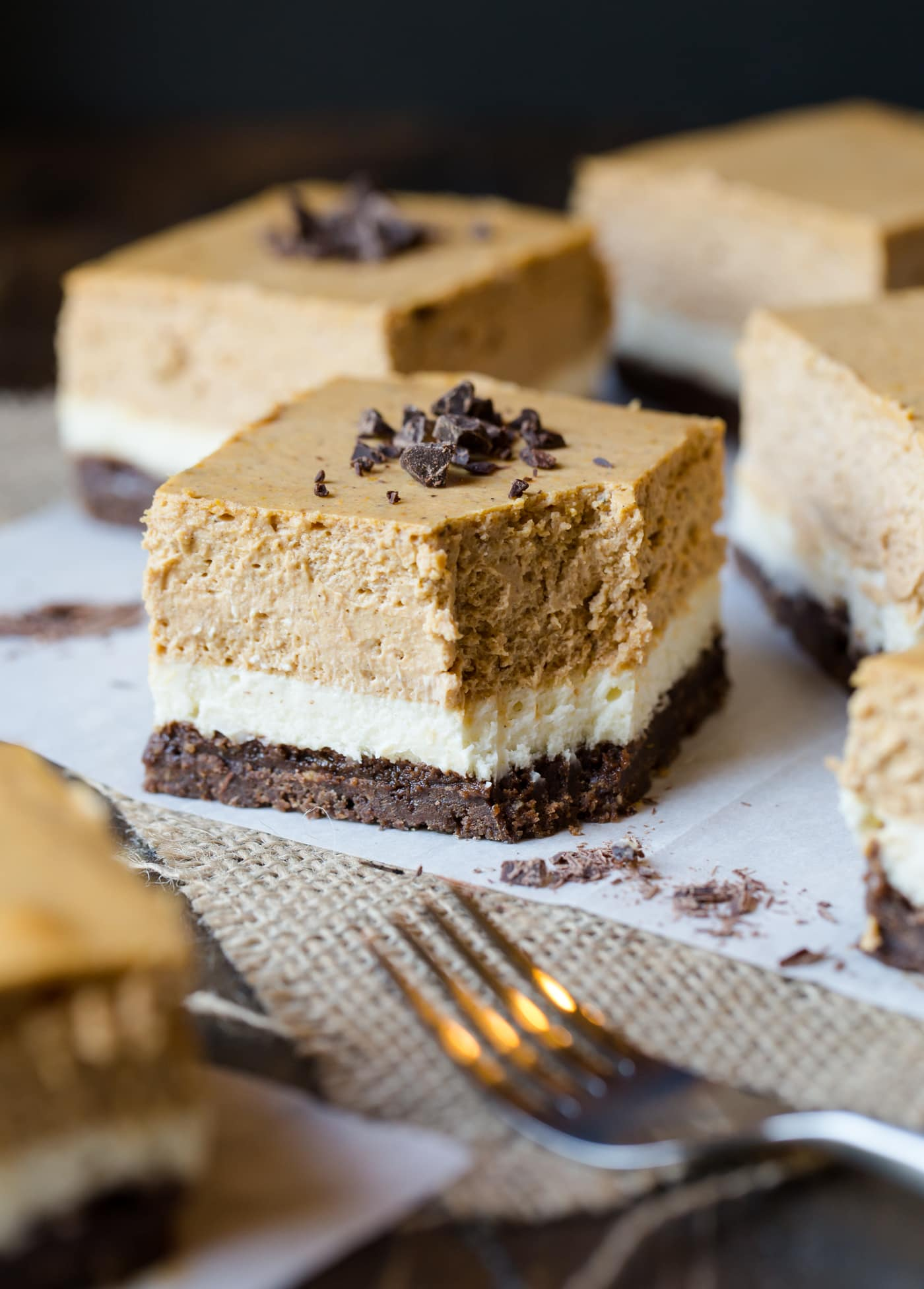 Gluten-free desserts don't have to be boring! These decadent Gluten-Free Chocolate Pumpkin Cheesecake Bars will change your mind about just how delicious gluten-free sweets can be!