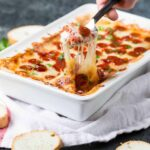 This Easy Pepperoni Pizza Dip recipe tastes just like pizza in dip form! What could be better?