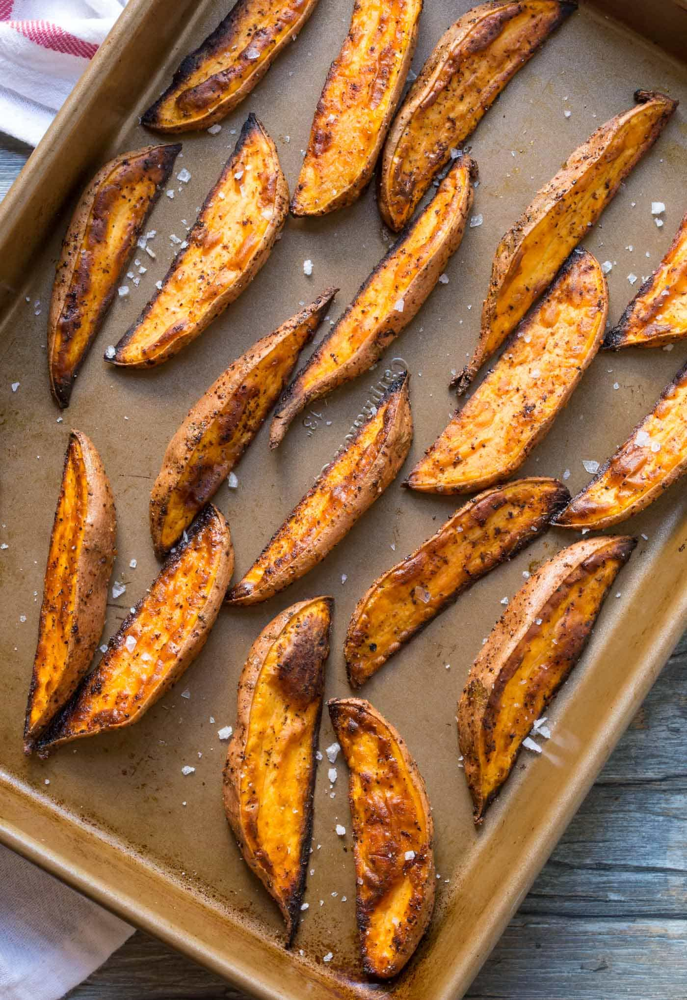 Need a quick and easy appetizer? These oven roasted Spicy Sweet Potato Wedges couldn't be simpler to make, and they pair well with nearly everything.