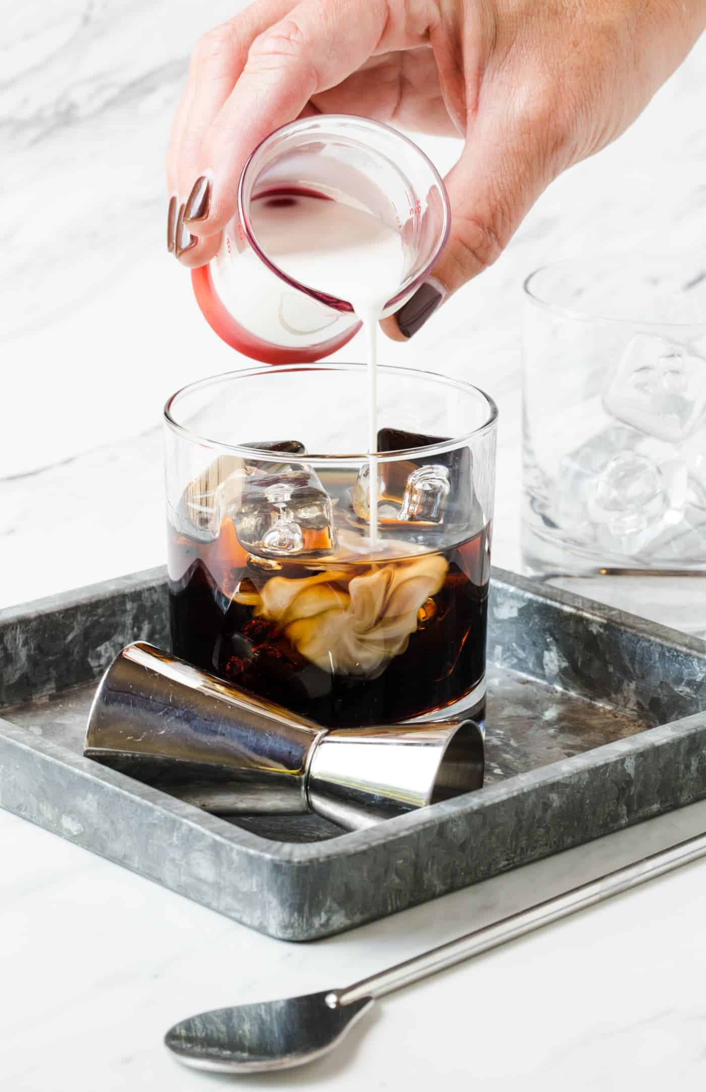 Craving coffee after dinner? Take your after dinner drink up a notch with this Classic White Russian cocktail!