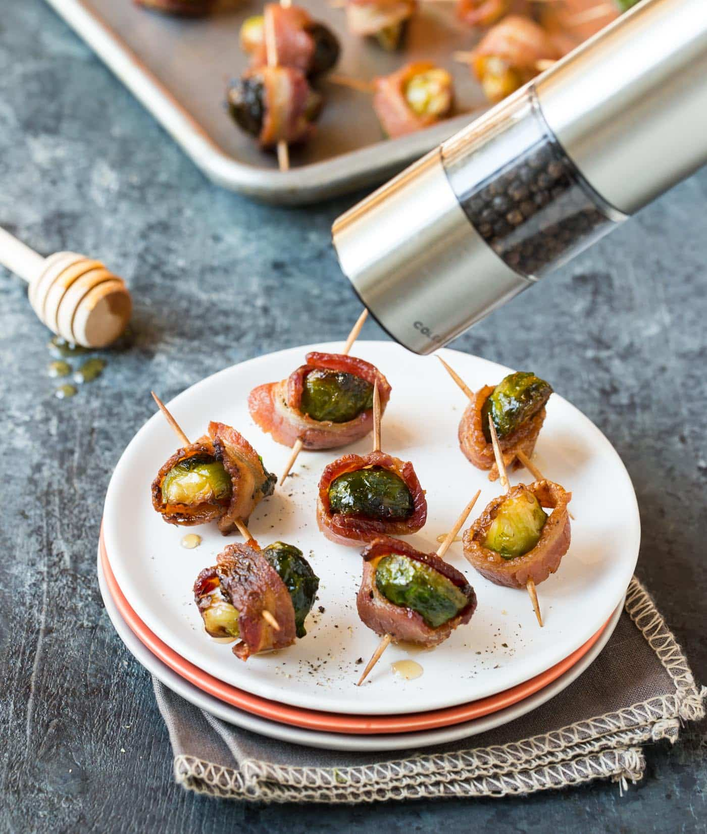 Need simple finger food for your next party? These make ahead Bacon Wrapped Brussels Sprouts with Maple Syrup are always a hit!