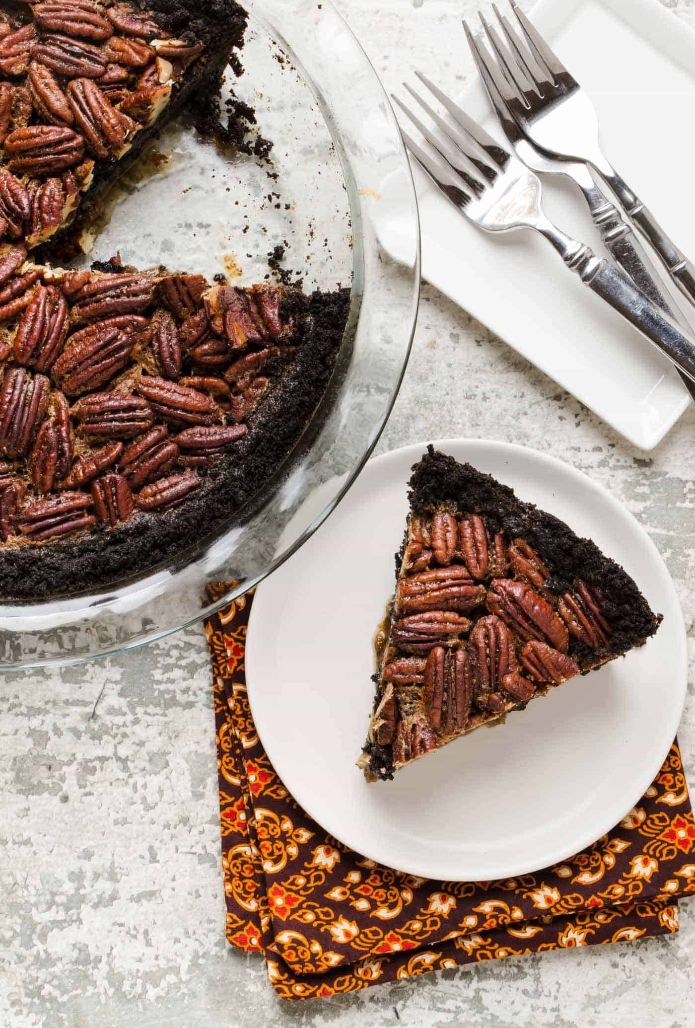 Add this recipe for make-ahead Bourbon Pecan Pie with Chocolate Cookie Crust to your holiday baking list. Your guests will love it!