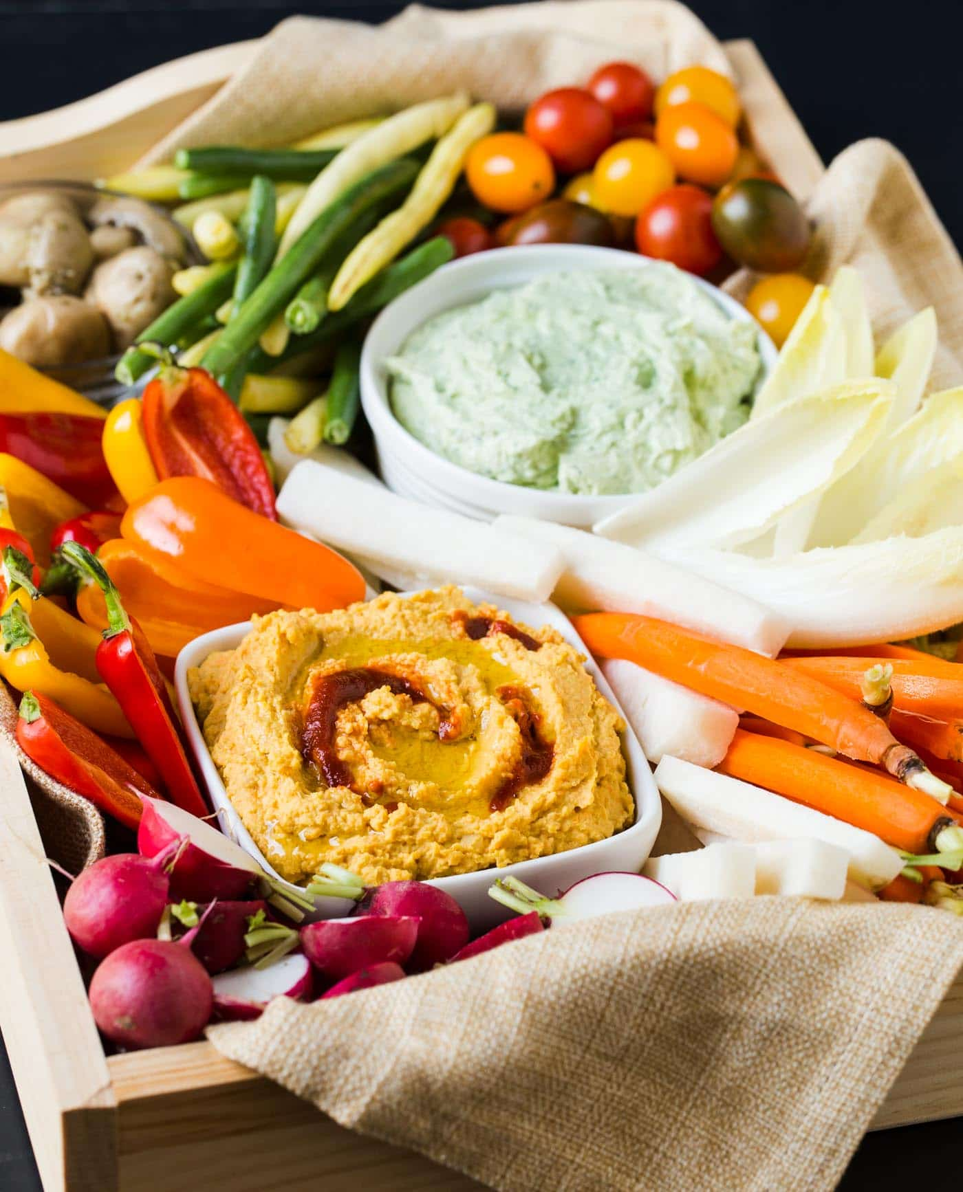 Say no to the sad store-bought veggie tray! Follow our simple suggestions for How to Build a Better Veggie Tray that your guests will love.