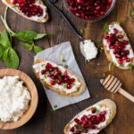 These super easy Pomegranate Crostini with Ricotta and Mint can be served as either a festive appetizer or slightly sweet dessert.