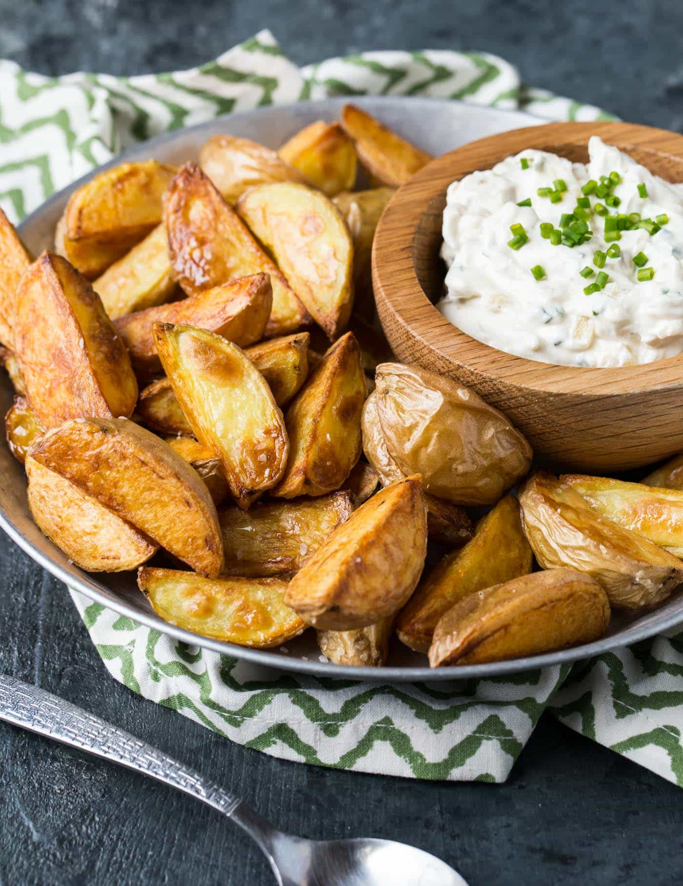 Homemade dip makes these Roasted Potatoes with Sour Cream and Onion Dip the hit of any appetizer spread.