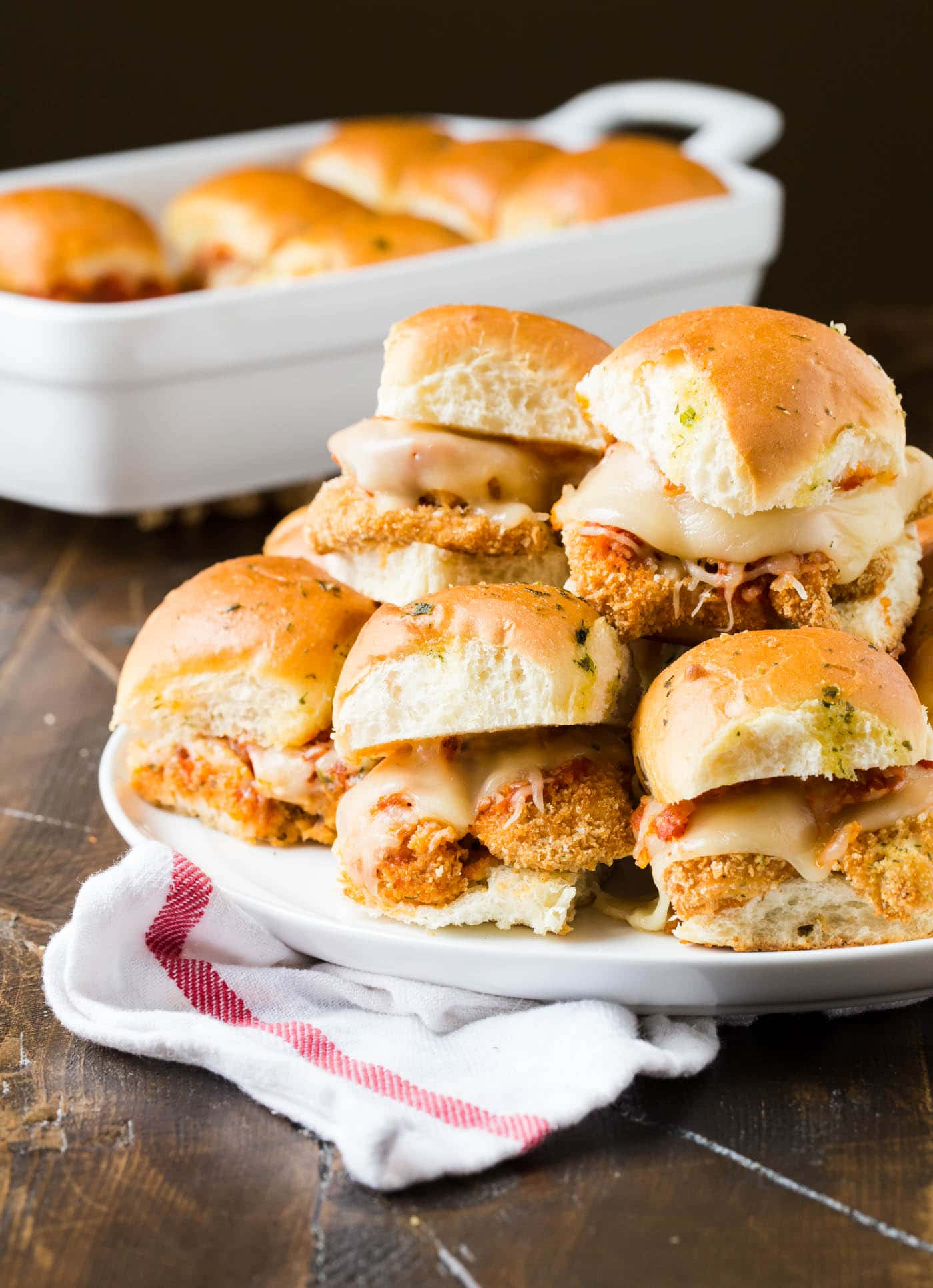 "These quick and easy Chicken Parmesan Sliders are the new ""must have"" party food for any get together. Great for game day, too!"