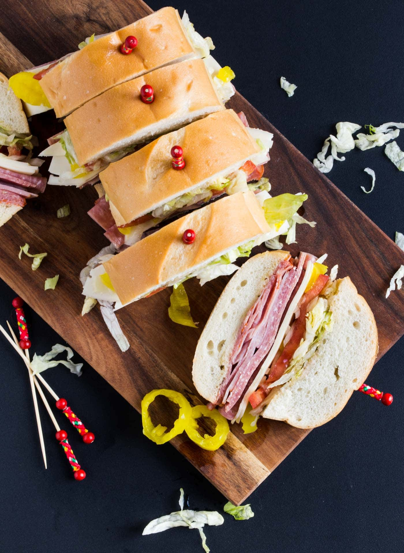 Three meats, provolone cheese and a red wine vinaigrette make this easy Italian Party Sub your go-to recipe for serving a crowd.