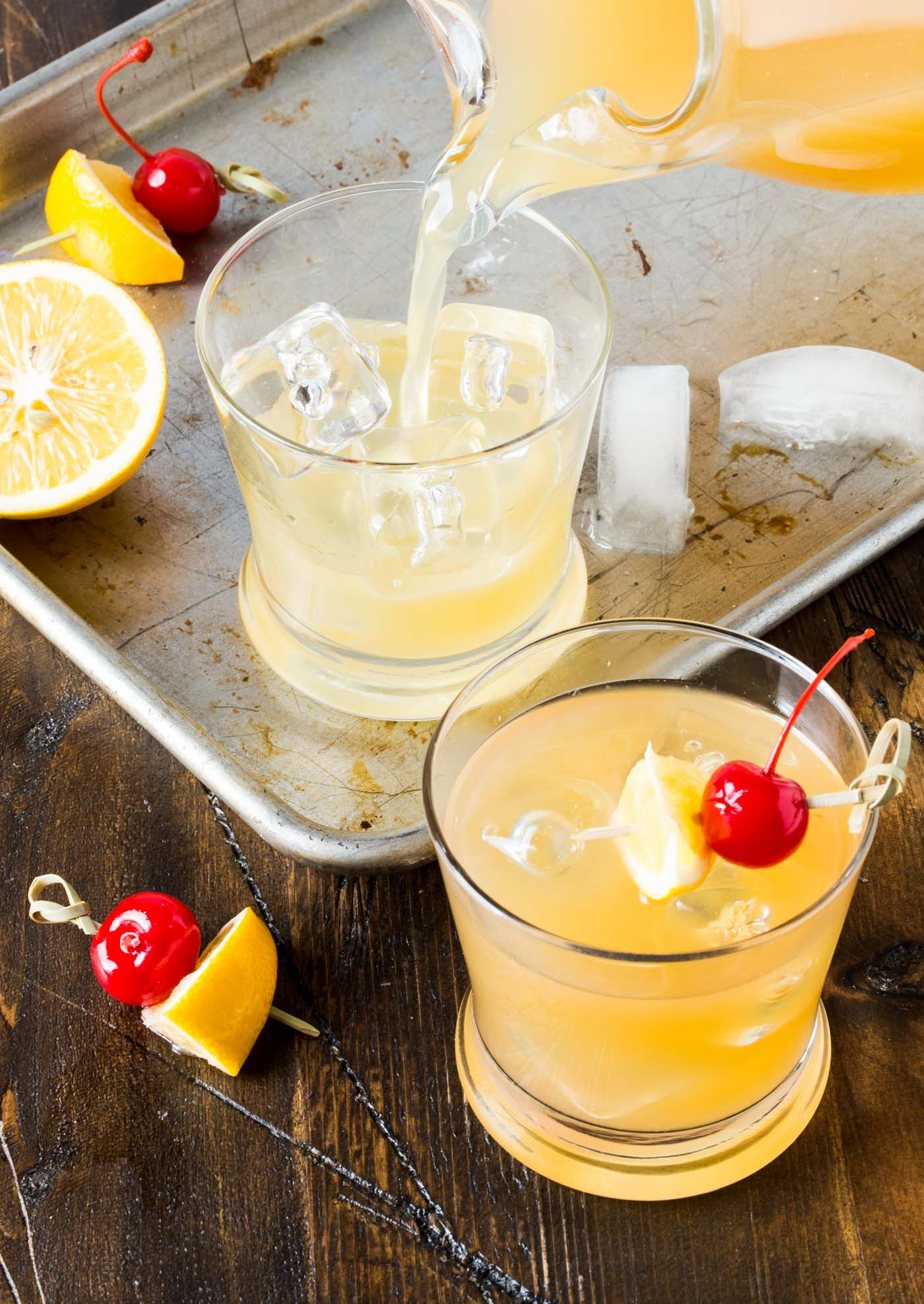 Whip up a pitcher of these Meyer Lemon Whiskey Sours for your next party, a fresh and tasty batch cocktail recipe that can be made ahead of time!