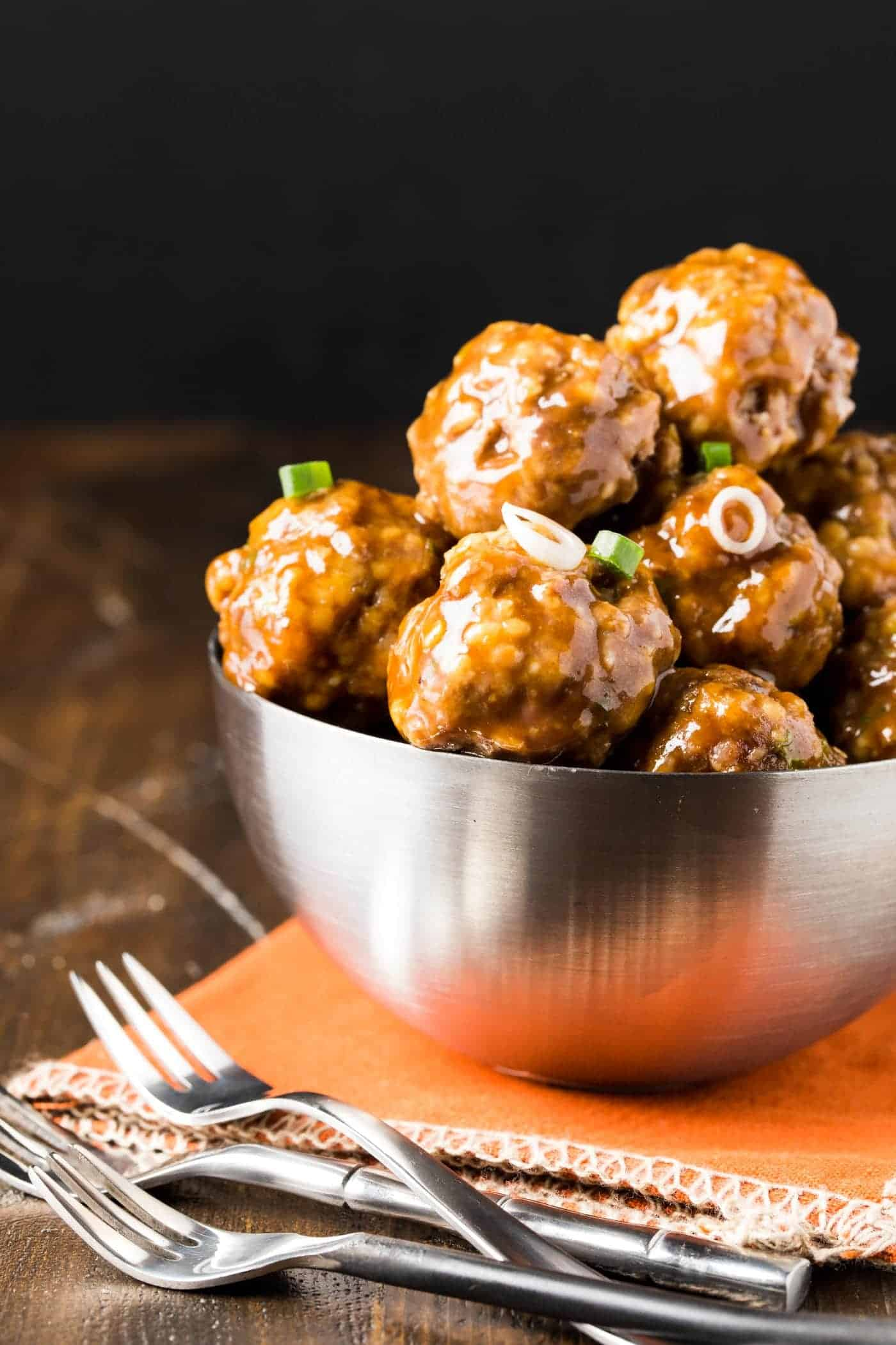 Appetizers don't get much easier than these make ahead Saucy Asian Meatballs! Pop them in the slow cooker to keep them warm all night long.