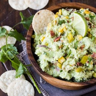 Corn and Bacon Guacamole-A fresh take on guacamole made with corn and bacon that will quickly move to the top of your must-make list!