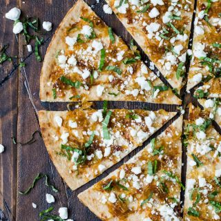 This Flatbread with Goat Cheese and Caramelized Onions always disappears at parties. Pin this recipe for later!