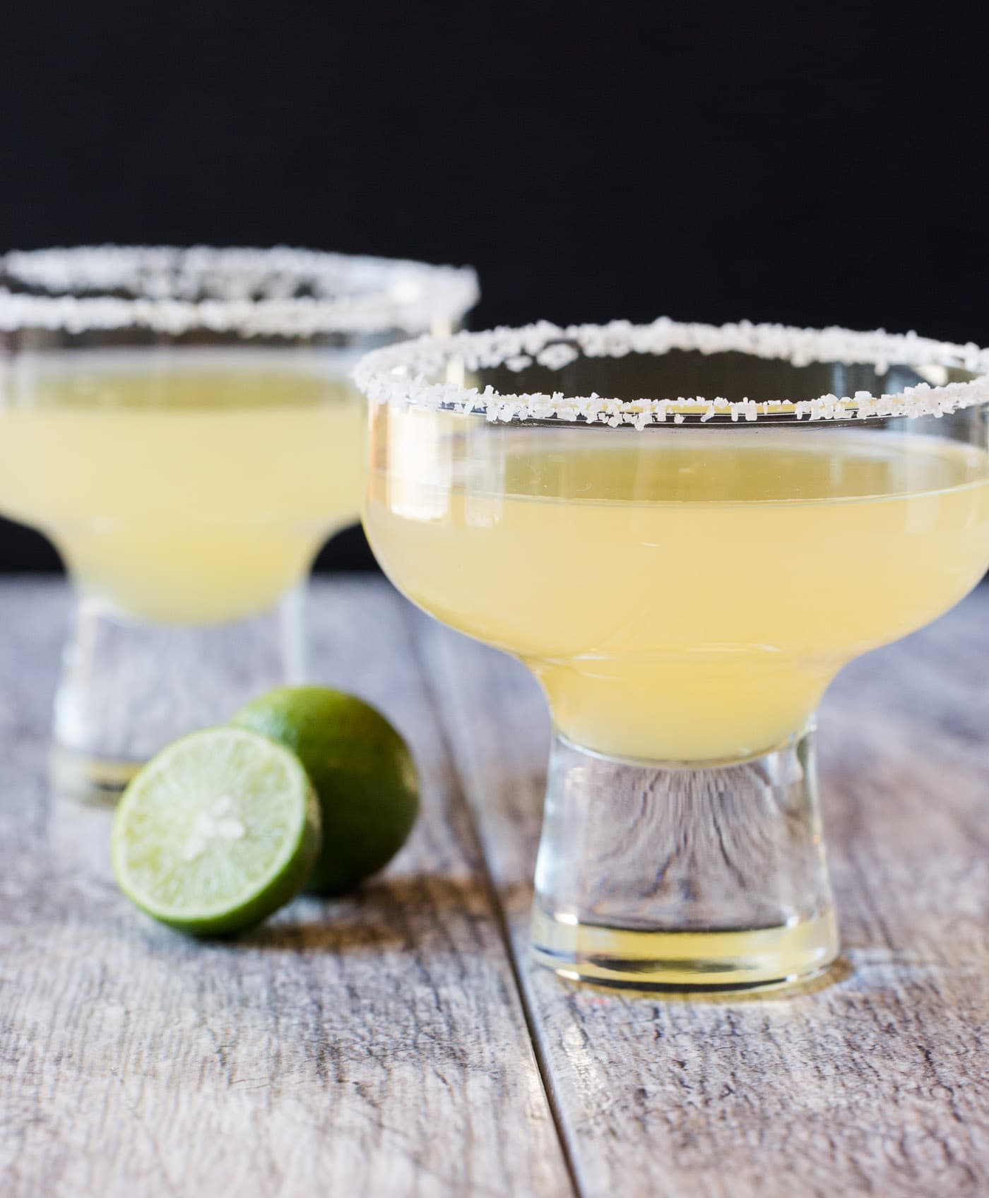 This Key Lime Margaritas recipe will bring the tropics to you with the perfectly balanced sweet and tart flavors!