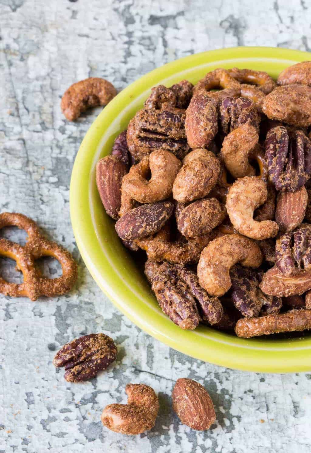 Add a little sweet heat to your appetizer spread with this make-ahead Spicy Sweet Pretzel Nut Snack Mix.