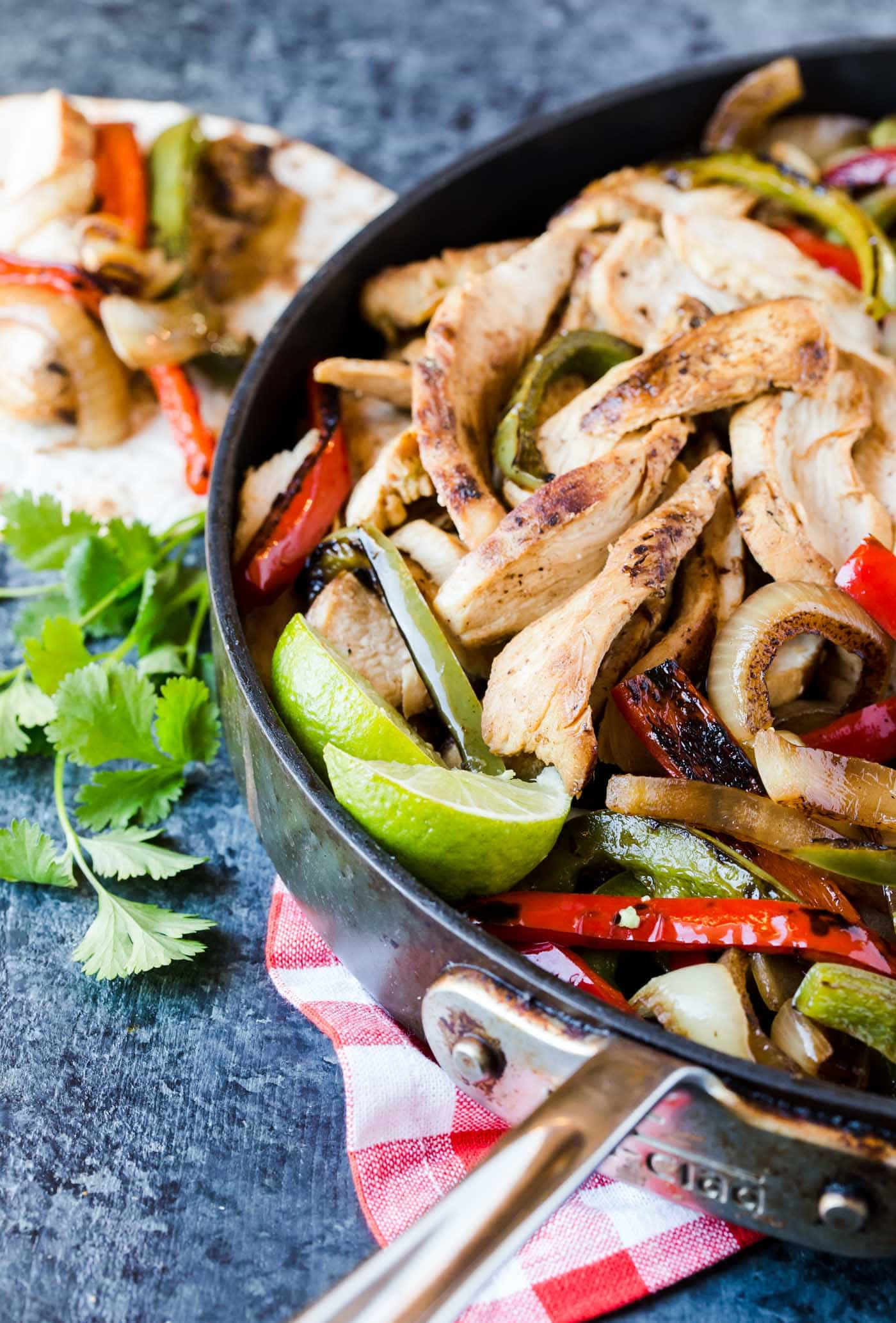 Double the recipe and turn your next party into a fiesta with these Tequila Lime Chicken Fajitas!