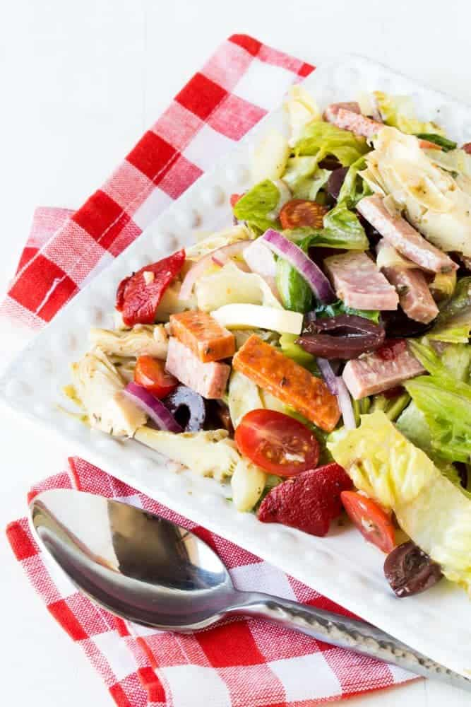 This easy Antipasto Salad with Red Wine Vinaigrette is a substantial salad packed with meats and veggies. Perfect for a summer BBQ!