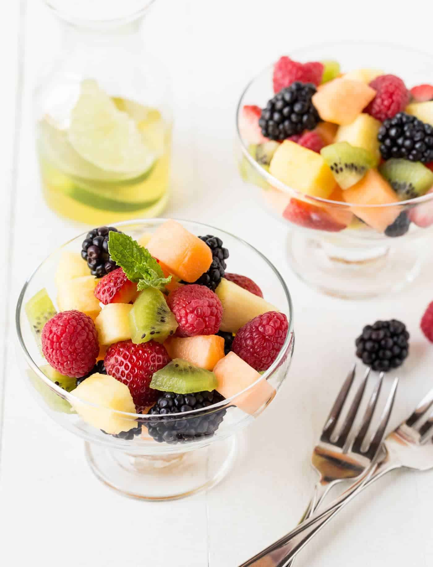 Bypass the tired grocery store fruit tray and impress your guests with this easy Fruit Salad with Lime Mint Syrup instead!