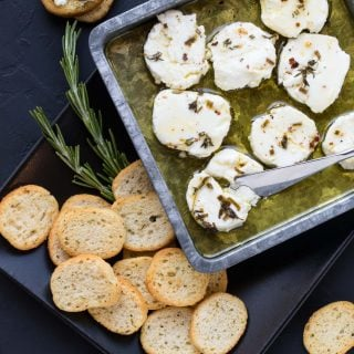 Calling all goat cheese lovers! This Marinated Goat Cheese Recipe is calling your name.