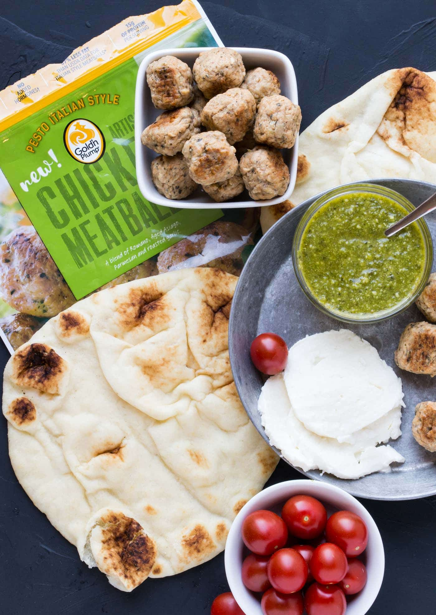 Need a quick and easy recipe for your impromptu happy hour? This Pesto Meatball Flatbread recipe delivers big flavor in less than 20 minutes!