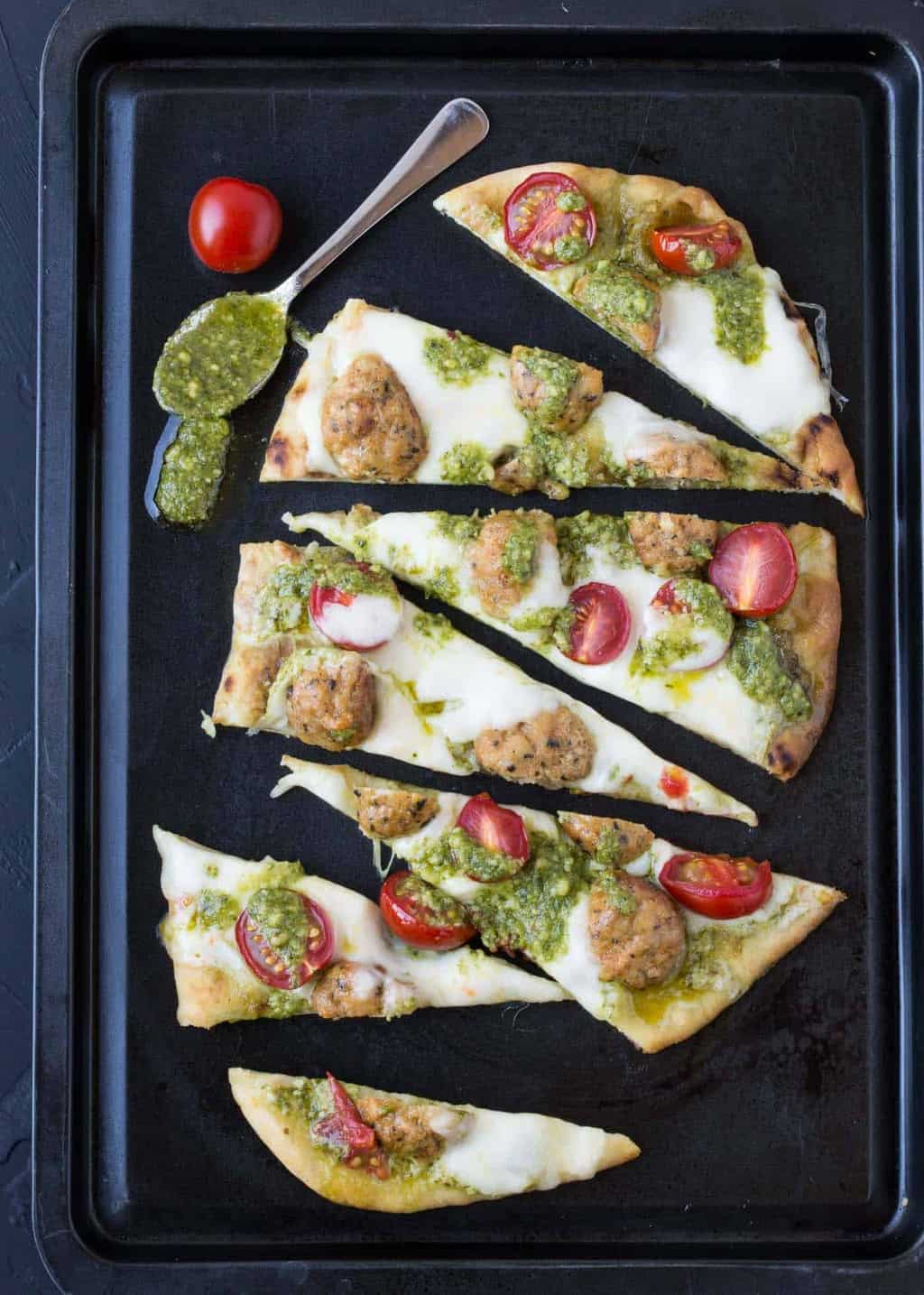 This Pesto Meatball Flatbread recipe delivers big flavor with fresh style and comes together in minutes - perfect for a last minute appetizer.