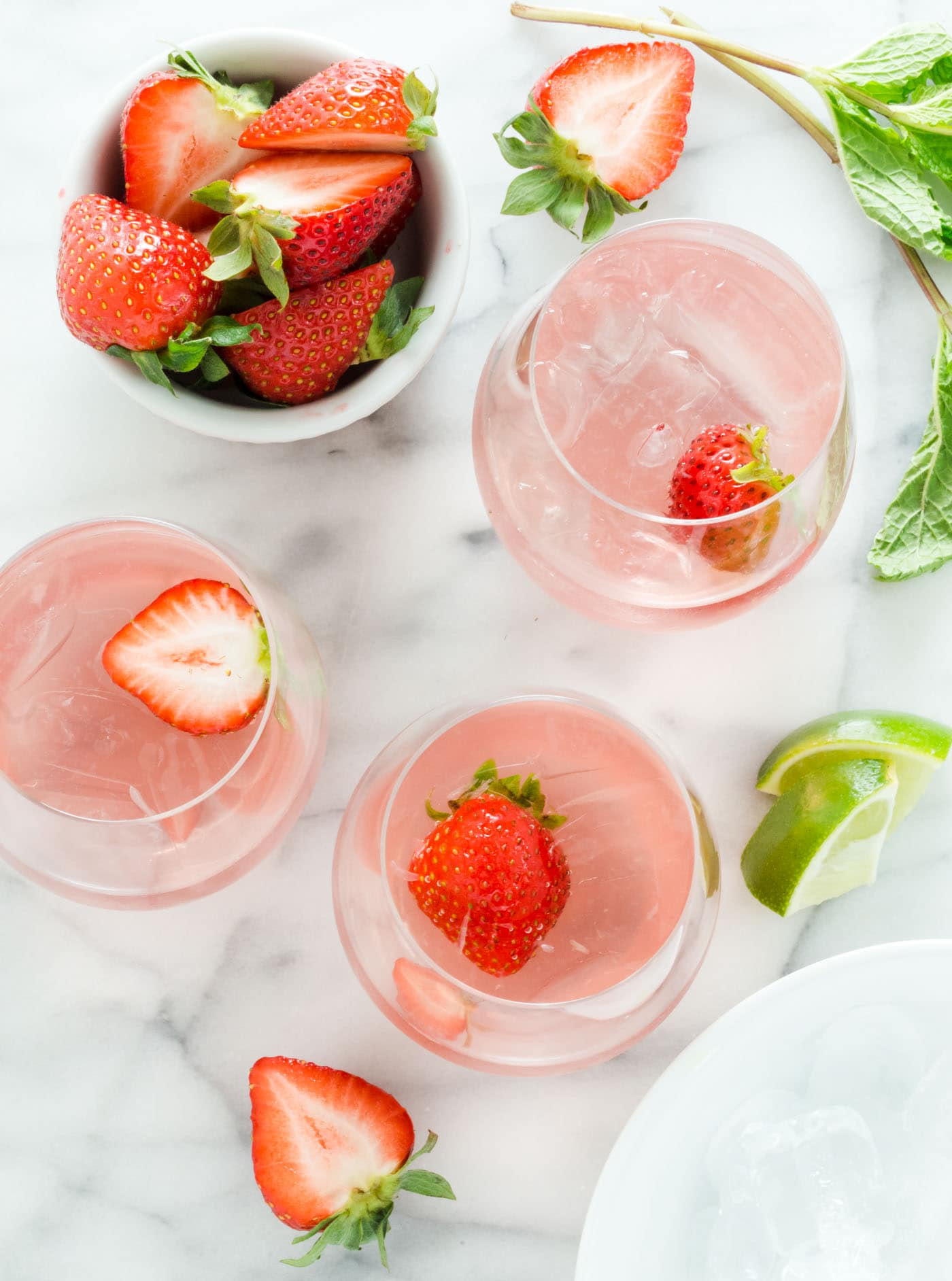 Hosting a backyard BBQ? Whip up a pitcher of these Bubbly Strawberry Rosé Mojitos for your guests and let them serve themselves while you enjoy the party.
