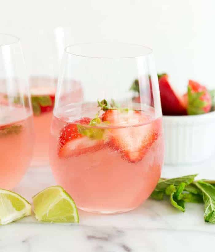 Everything always prettier in pink, and these Bubbly Strawberry Rosé Mojitos are no exception. This recipe is a great batch cocktail for groups!