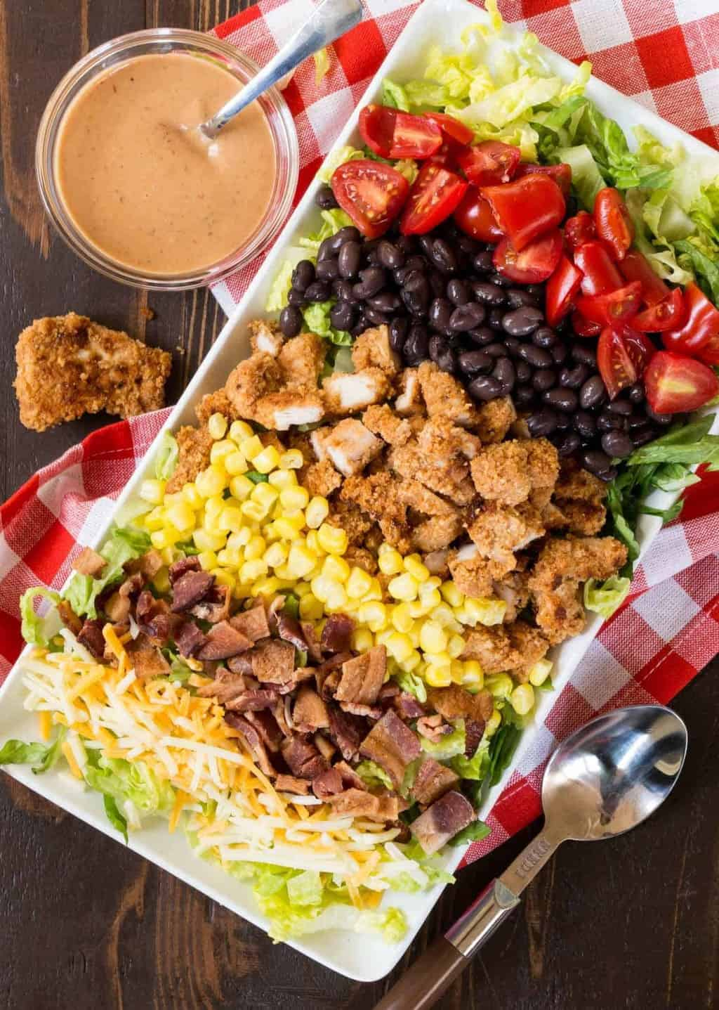 One of the biggest challenges when entertaining is making sure you are not stuck in the kitchen while your guests enjoy the party. Add this make-ahead Crunchy Honey BBQ Chicken Salad to your summer party menus and enjoy more time with your guests and less time prepping food.