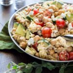 Need a protein-packed vegetarian pasta salad? This Easy Orzo and Chickpea Salad is a great recipe for backyard BBQs!