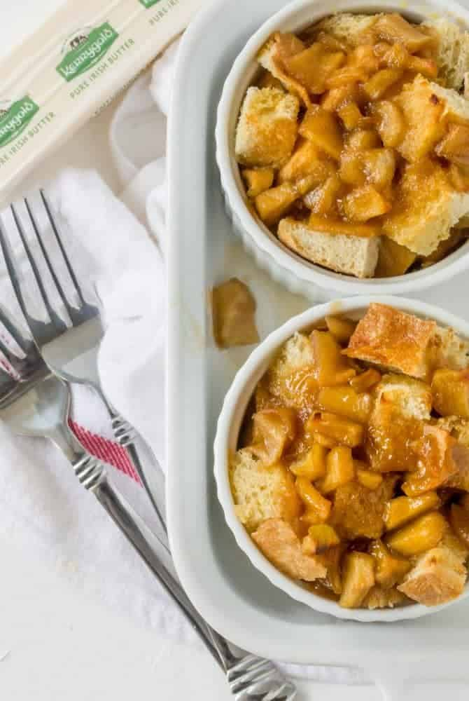 caramel apple french toast cups in white ramekins with forks and white tray