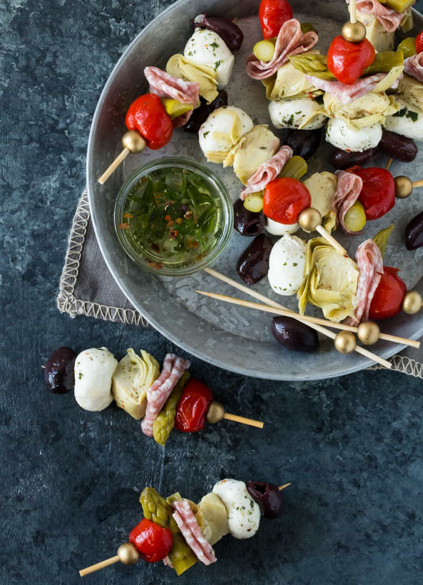 Make-ahead Antipasto Skewers are easy to tailor to personal taste and come togehter in no time. Party food perfection!
