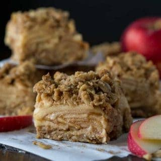 Slices of Apple Crisp Bars on parchment paper.