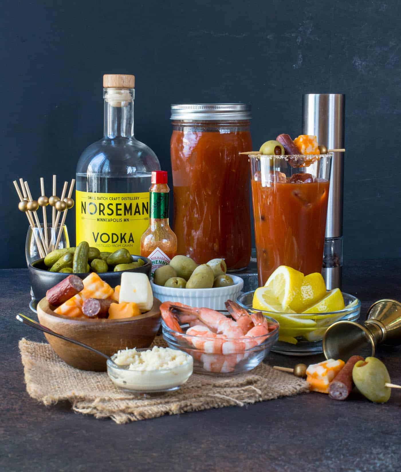 Bloody Mary Bar complete with vodka, , shrimp, salami, olives and cheese for garnishes.