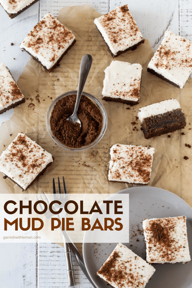 Top down image of cut Chocolate Mud Pie bars recipe on white background with chocolate graham cracker crumbs for garnish.