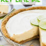 Key Lime Pie with slice out and garnished with a fresh lime wedge.