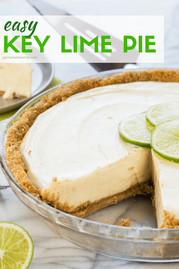 Easy Key Lime Pie with slice out and garnished with a fresh lime wedge.