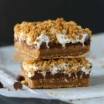 Two Gooey Baked S'mores Bars on top of each other.