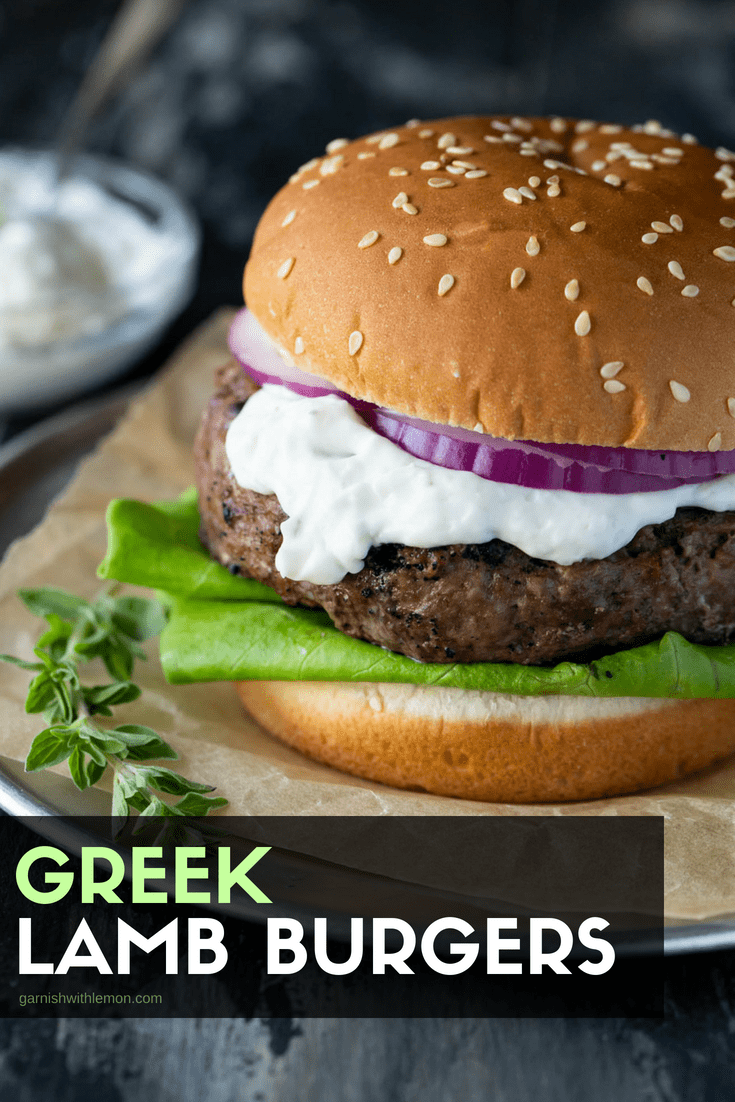 Greek Lamb Burgers on a sesame seed bun with tzatziki and goat cheese.