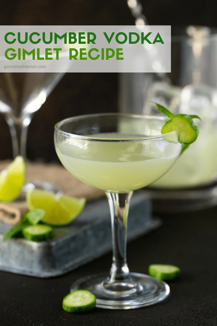 Cucumber Vodka Gimlet recipe in coupe glasses. Garnished with fresh cucumber, basil and lime wedges.