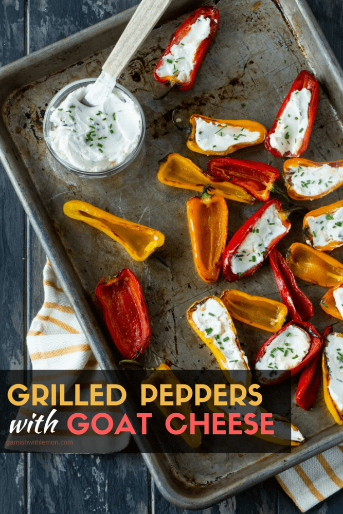 Top down image of Grilled Peppers with Goat Cheese on sheet pan with a yellow and white striped towel underneath.
