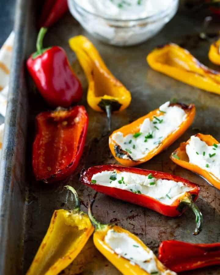 stuffed mini peppers on a sheet pan.
