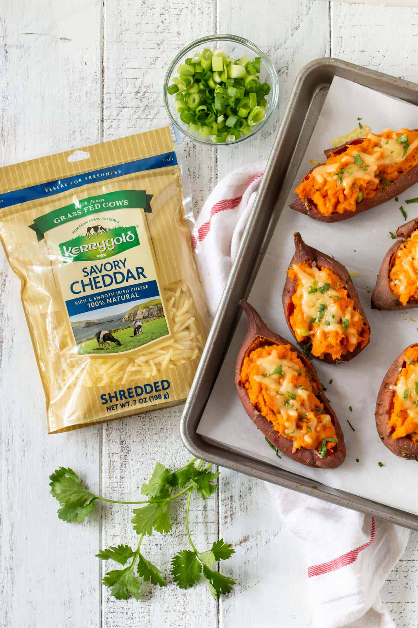 Top down image of Cheesy Chipotle Twice Baked Sweet Potatoes on Baking tray.