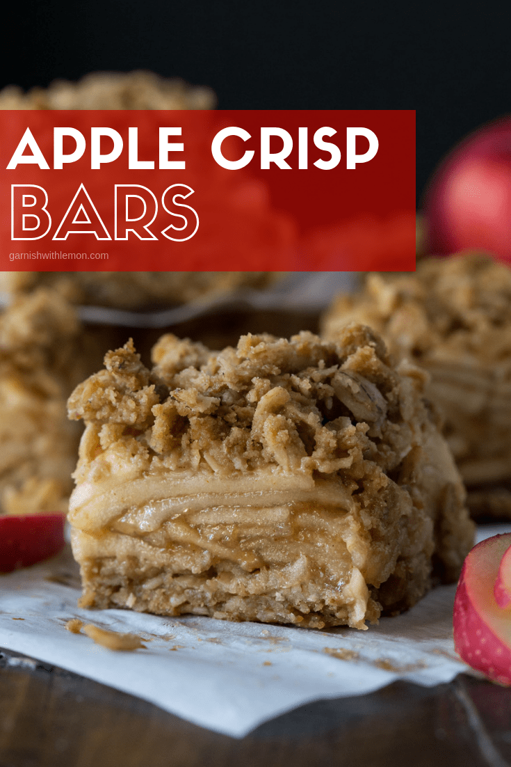 Slices of Apple Crisp Bars on parchment paper. Surround by apple slices.