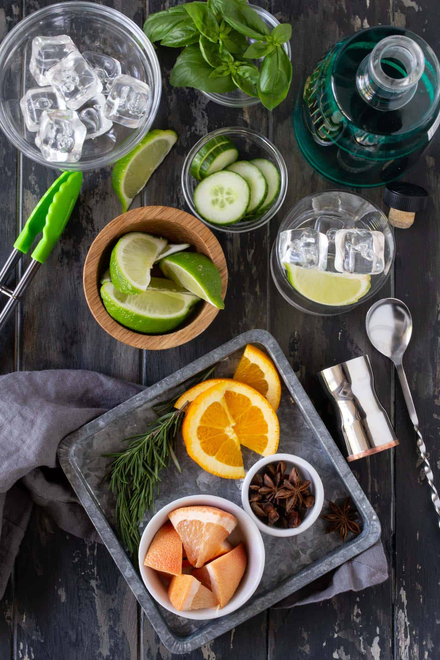 Garnishes, tonic water and gin set up for a DIY Gin & Tonic Bar