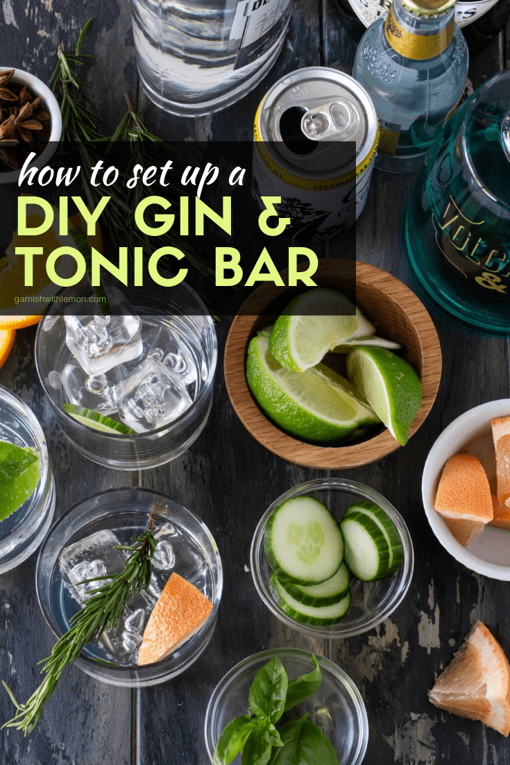 Ice filled glasses, cocktail garnishes, gin bottles and tonic water for a DIY Gin & Tonic Bar