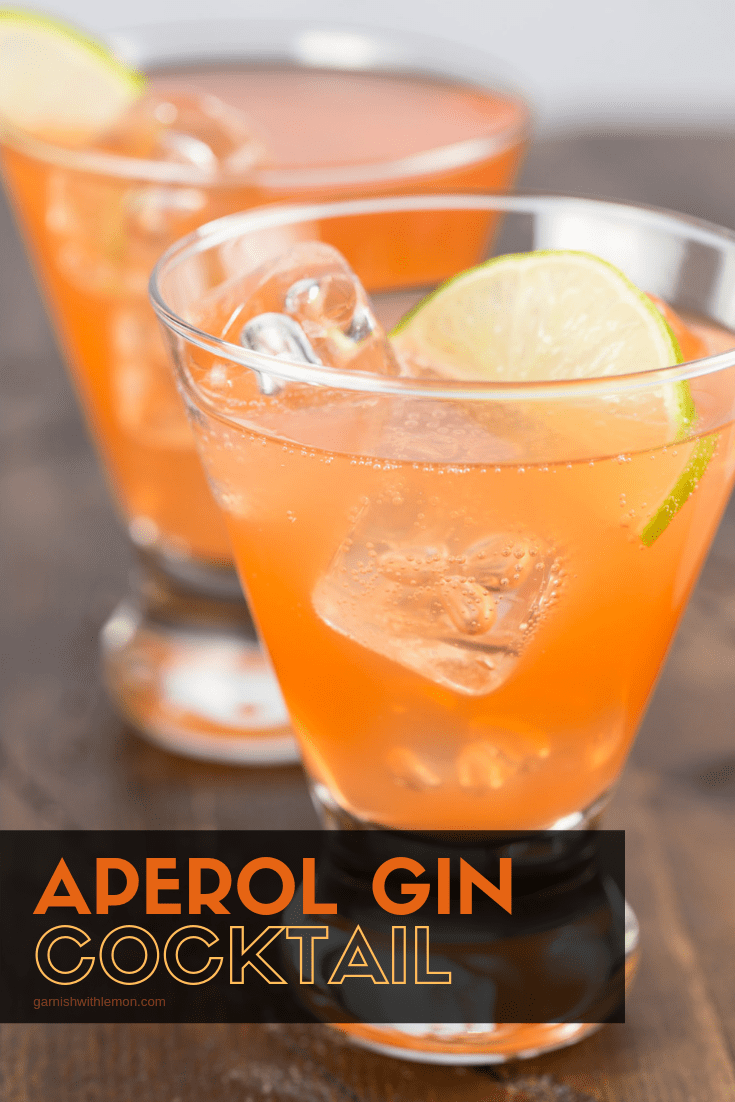 Imageof two Aperol Gin cocktails with lime wedge for garnish.