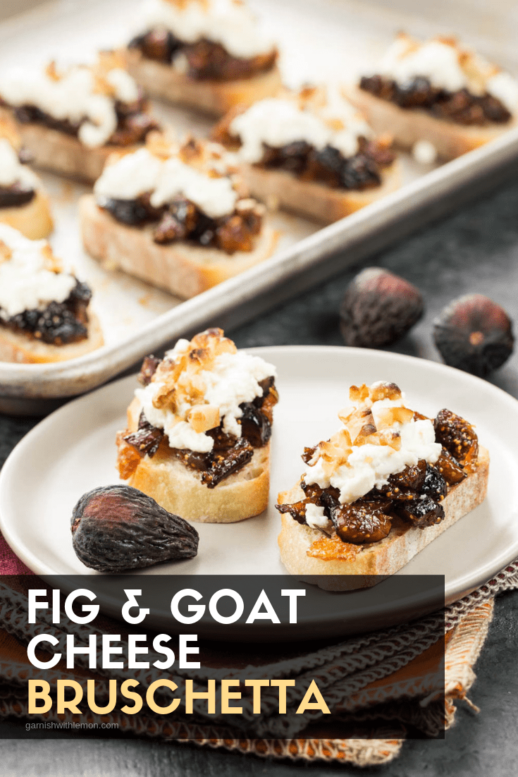 Image of fig and goat cheese appetizers on a white plate with fresh figs for garnish.