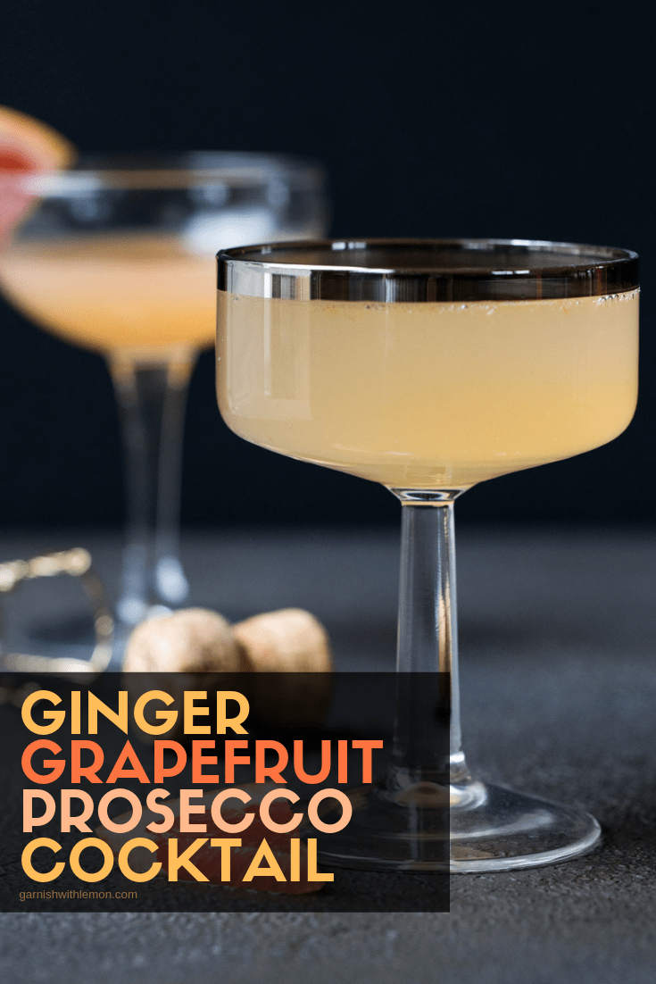 IMage of Ginger Grapefruit Prosecco Cocktail in champagne flute with fresh grapefruit wedge for garnish.