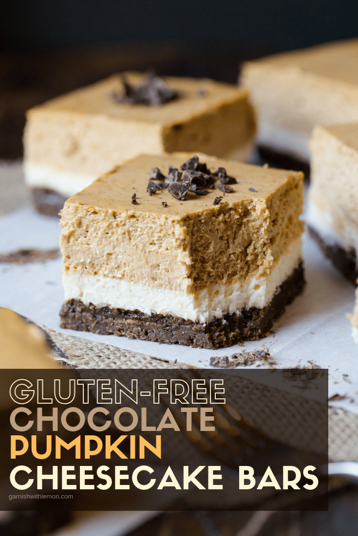 Image of GLuten Free Layered Pumpkin Chocolate Cheesecake Bars with chocolate shavings on top.